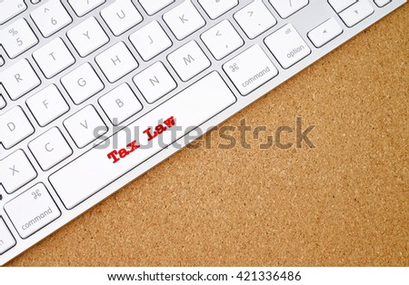 Business concept : Tax Law on computer keyboard background with copyspace area.  - stock photo