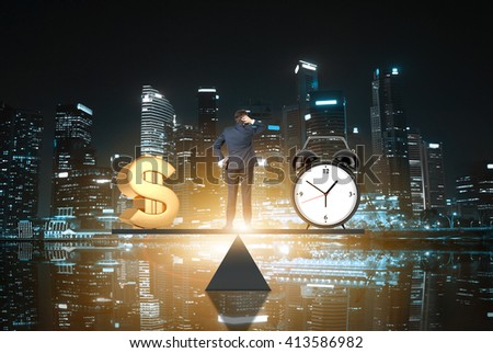 Business concept, time is money. Businessman on scale making decisions between money and clock with night time Singapore city in the background - stock photo
