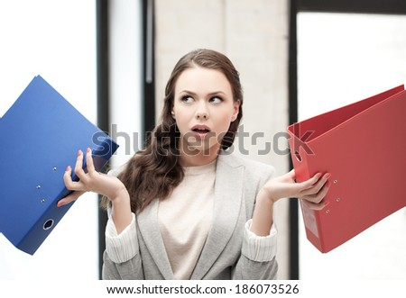 business concept - unsure thinking or wondering woman with folder - stock photo