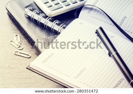 Business concept with agenda, mobile phone and calculator - stock photo