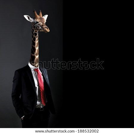 Business concept with businessman with head of Giraffe - stock photo