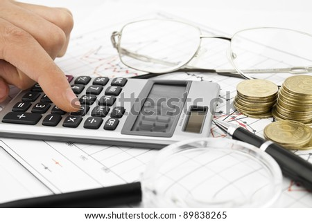 Business concept with calculator, money, glasses and pen - stock photo