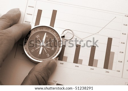 business concept with compass and diagram or chart - stock photo