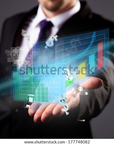 Business concept with manager holding virtual scheme with graphs
