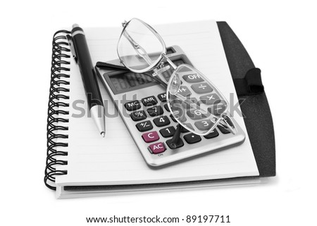 Business concept with notebook and calculator on white - stock photo
