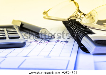 Business concept with notebook, glasses, pen and calculator - stock photo