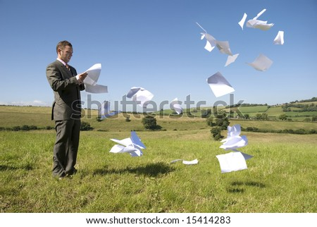 Business concept with paperwork flying everywhere! - stock photo