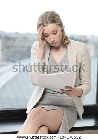 business concept - worried woman with documents - stock photo