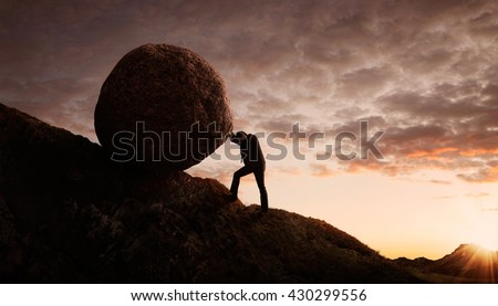 Business concept, Young businessman pushing large stone uphill with copy space - stock photo