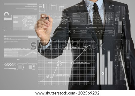 Business Concepts. Businessman drawing some graphs - stock photo