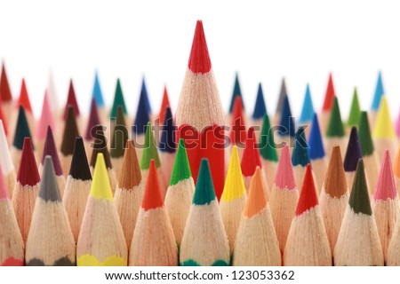 Business concepts: red crayon standing out from the crowd - stock photo