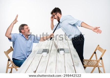 Business conflict. The two men expressing negativity while one man grabbing the necktie of her opponent on white background - stock photo