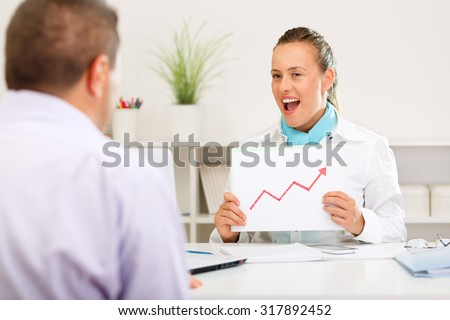 Business consultant informing the client of growing interest rates - stock photo