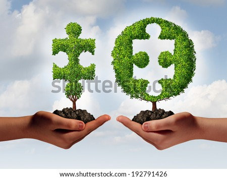 Business consulting advising and financial consulting concept with a hand offering a jigsaw puzzle piece tree to another hand with a missing part as a perfect fit metaphor for expert solutions. - stock photo