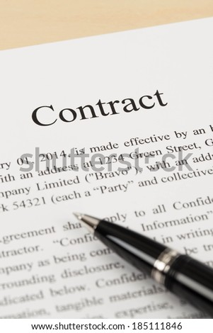 Business contract document with pen close-up
