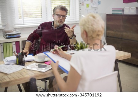 Business conversation behind the glass wall - stock photo