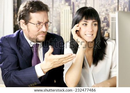 Business couple angry about stock market - stock photo