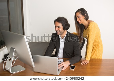 Business couple happy working at the computer - stock photo