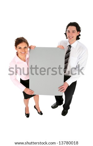 Business couple holding blank poster board - stock photo