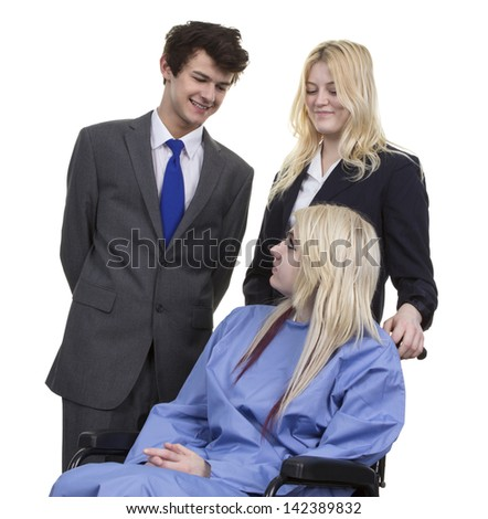 Business Couple Looking At Women Sitting On Wheelchair Isolated On White Background