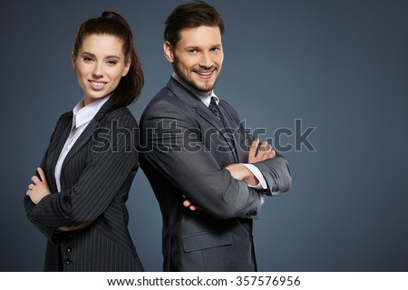 Business couple on blue background - stock photo