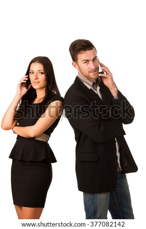 Business couple standing together and talking over phone, leaning with shoulders.