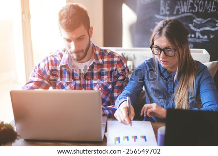 Business Couple Working from home - stock photo