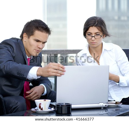 Business couple working with laptop