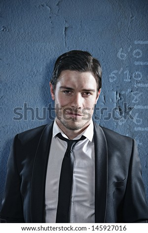 Business criminal poses for his mug shot - stock photo