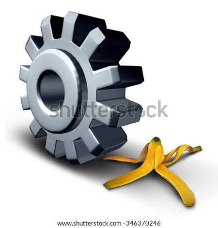 Business danger concept and risk ahead symbol or work injury and worker compensation claim due to working hazard as a gear wheel or cog rolling on to a slippery banana peel. - stock photo