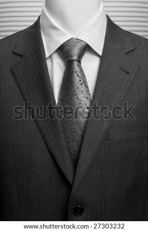 business dark grey suite with white shirt and tie