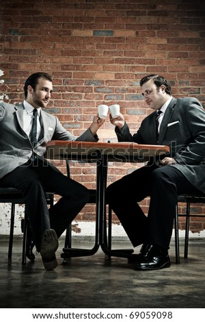 Business deal in a cafe, agreed with cappuccinos - stock photo