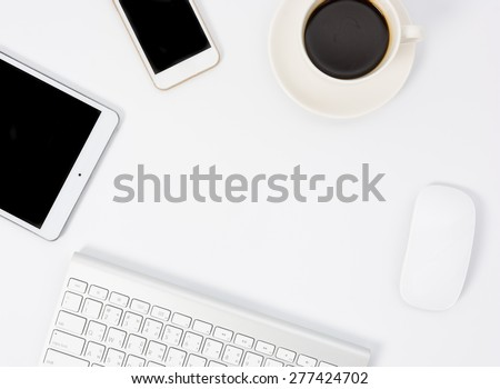 Business desk with a keyboard, mouse and pen on white table