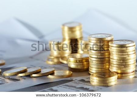 Business diagram on financial report with coins - stock photo
