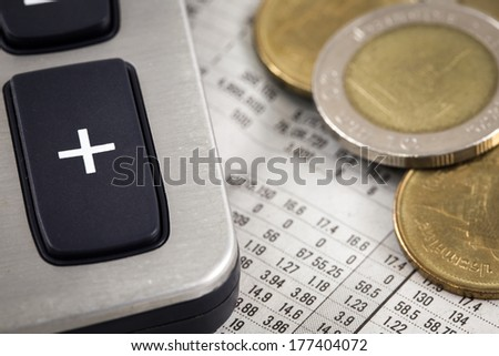 Business diagram on financial report with coins. Accounting - stock photo