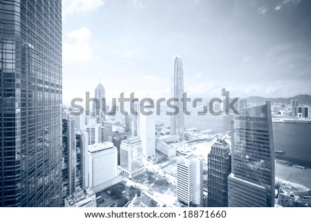 Business district skyline - blue tone (Vertical version: #18871684 / Regular colors: #17626312) - stock photo