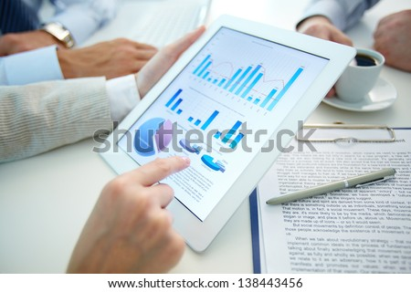 Business document in touchpad held by female during explanation - stock photo