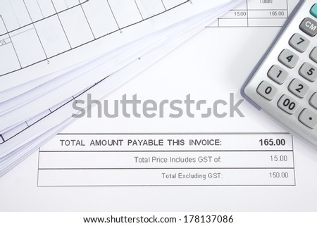 Business document of tax invoice form with calculator  - stock photo