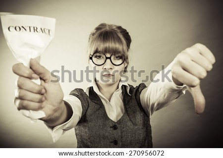 Business, documents and crisis concept - serious unhappy businesswoman showing crumpled contract making thumb down hand sign - stock photo