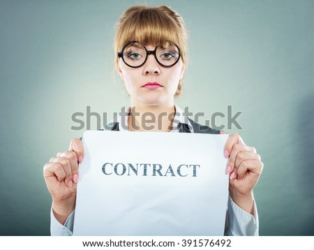 Business, documents and legal concept - serious unhappy businesswoman showing crumpled contract - stock photo
