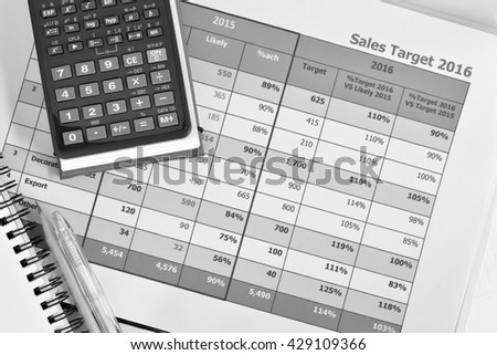 Business documents and office supplies at workplace,sales report,black and white concept. - stock photo