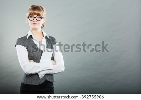 Business documents legal concept - closeup serious businesswoman holding contract in hand - stock photo