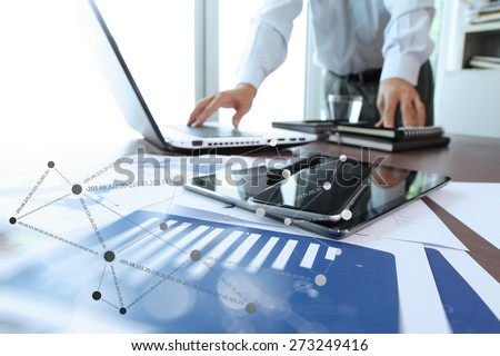 business documents on office table with digital tablet and man working with smart laptop computer background with social network diagram concept  - stock photo