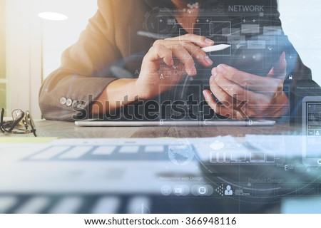 business documents on office table with digital tablet computer with smart phone and graph business financial diagram and businessman working in the background - stock photo