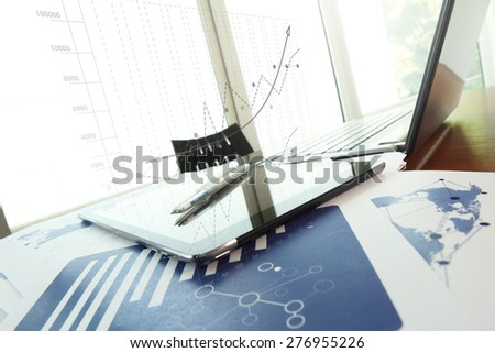 business documents on office table with pen and digital tablet as work space business concept - stock photo