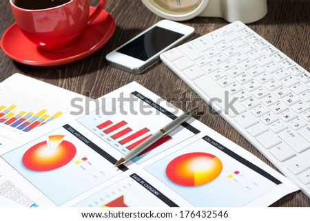 business documents with charts growth, keyboard and pen. workplace businessman - stock photo