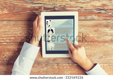 business, education, people, internet and technology concept - close up of male hands pointing finger to webpage article on tablet pc computer screen and coffee cup at table - stock photo