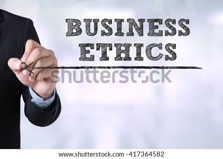BUSINESS ETHICS Businessman drawing Landing Page on blurred abstract background