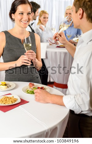 Business event two colleagues celebrate drink champagne enjoy catering buffet - stock photo