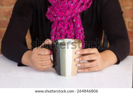 Business executive having a cup of coffee in her office or workplace - stock photo